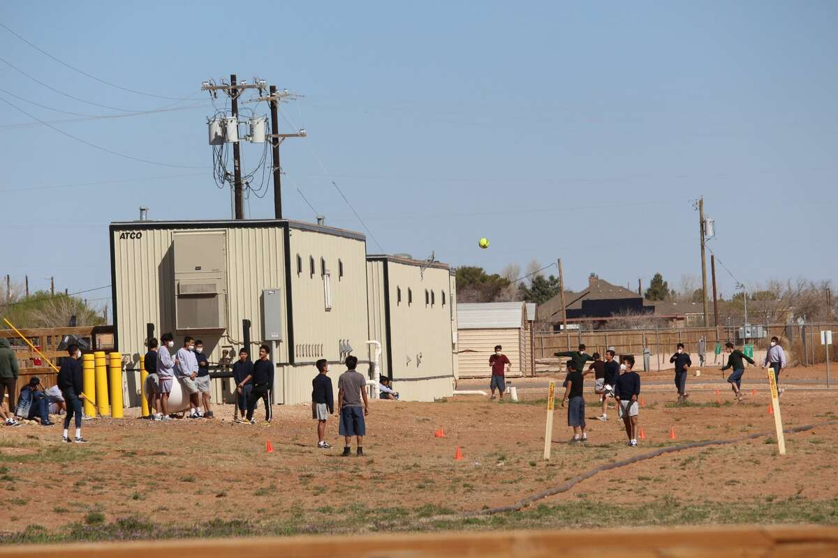 Juveniles at the facility in Midland County for unaccompanied migrants who crossed the U.S.-Mexico border are seen playing outside on Thursday March 18, 2021. The holding facility was opened March 14, 2021. (Mercedes Cordero/Midland Reporter-Telegram)