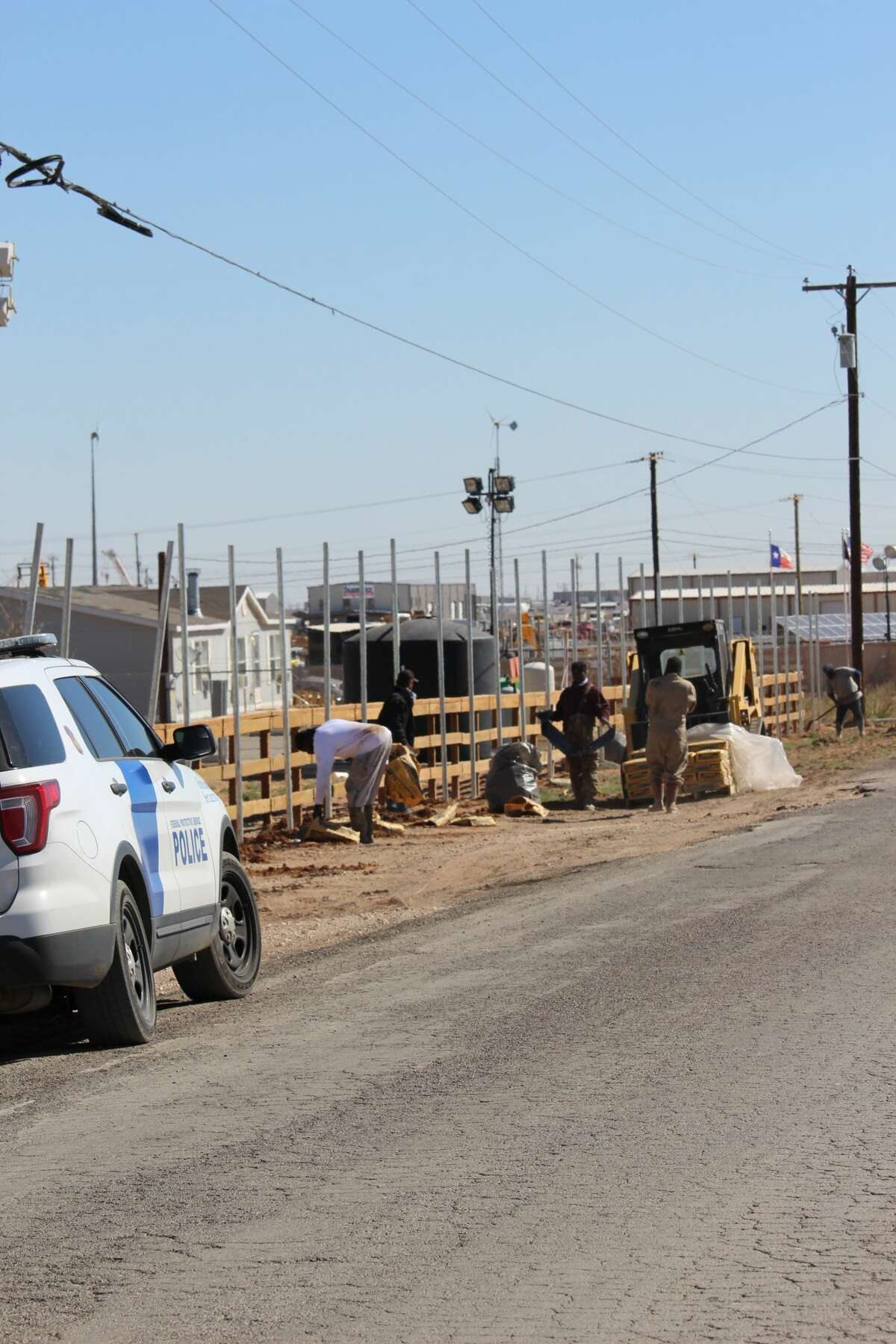 A fence is being built around the facility in Midland County that is housing unaccompanied juvenile migrants who crossed the U.S.-Mexico border on Thursday March 18, 2021. (Mercedes Cordero/Midland Reporter-Telegram)