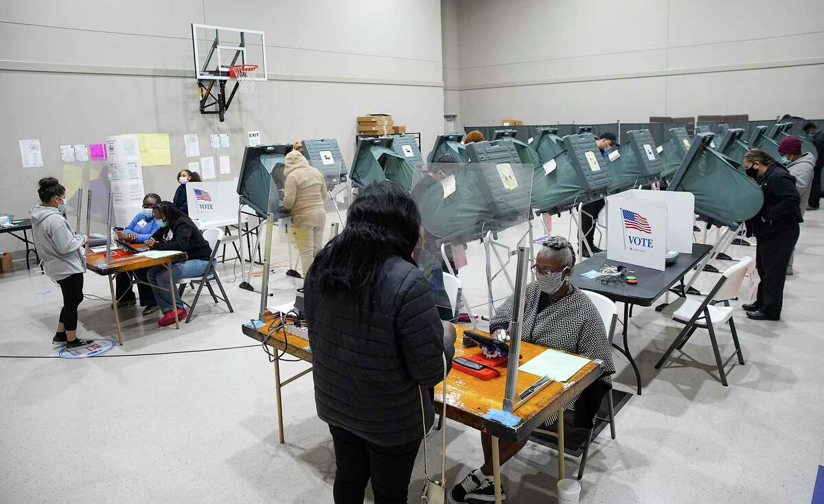 Voters cast their ballots at Victory Houston polling station in Houston on Friday, Oct. 30, 2020. The location was one of the Harris County's 24-hour locations.
