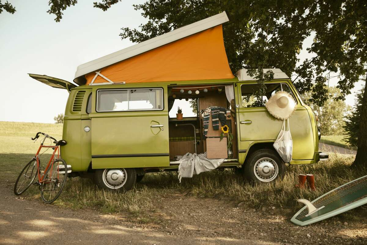 Van with roof tent in the nature