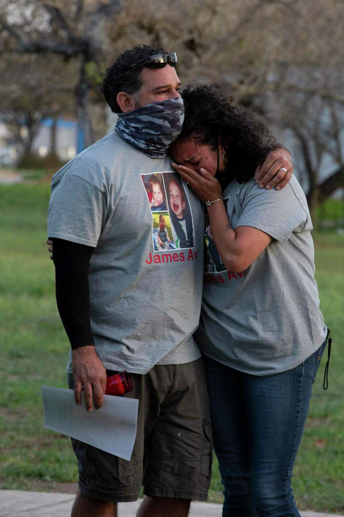 Jerry Gomez holds his wife Mariesol at a vigil for their great nephew, 19-month-old James Avi Chairez who has not been seen since January. His mother, D'Lanny Chairez, has been arrested but has not said anything about James' whereabouts.