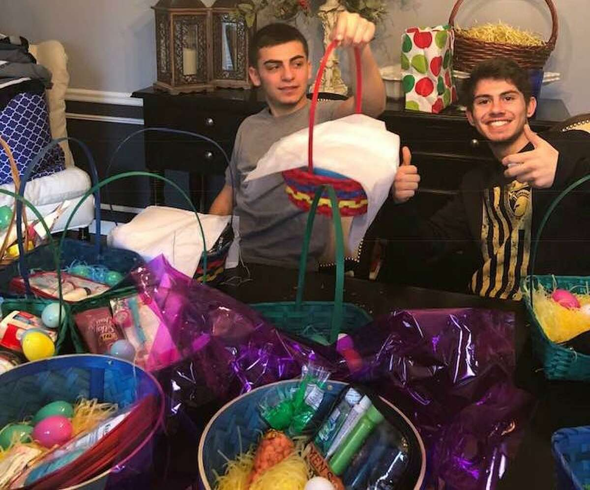 The DiMatteo family helps create Easter baskets to be delivered to shelters in Norwalk and Stamford. The baskets are being donated by DiMatteo Financial, DiMatteo Insurance and ACBI Insurance, all located in Shelton.