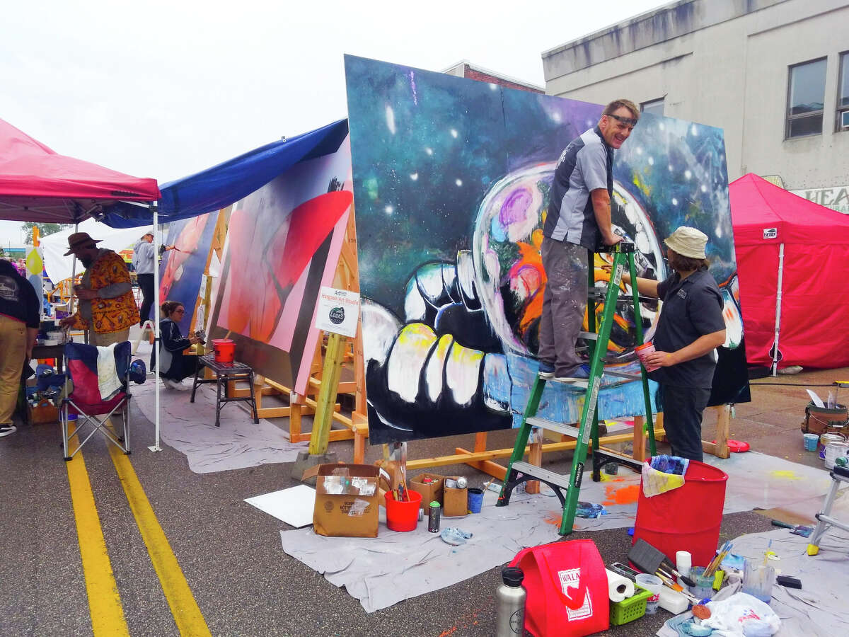 The team from Hargash Artist Studio works on their mural during the Midland Center for the Arts Summer Art Fair Saturday, June 1, 2019. (Photo provided/Chandra Jewell)