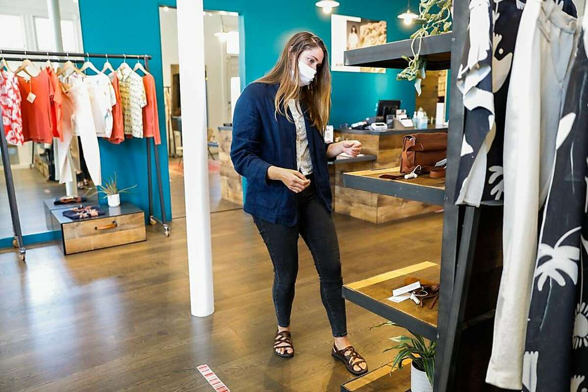 Store manager Kathryn Sandretto works at Acote boutique on Hayes Street in Hayes Valley on Wednesday, June 17, 2020 in San Francisco.
