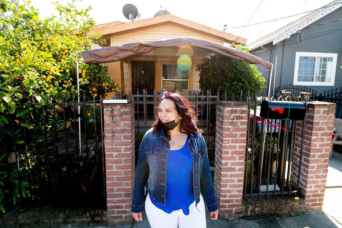 Patricia Toscano, mother of Golden State Warriors forward Juan Toscano-Anderson, stands outside his childhood home in Oakland, Calif., on Sunday, Feb. 28, 2021.