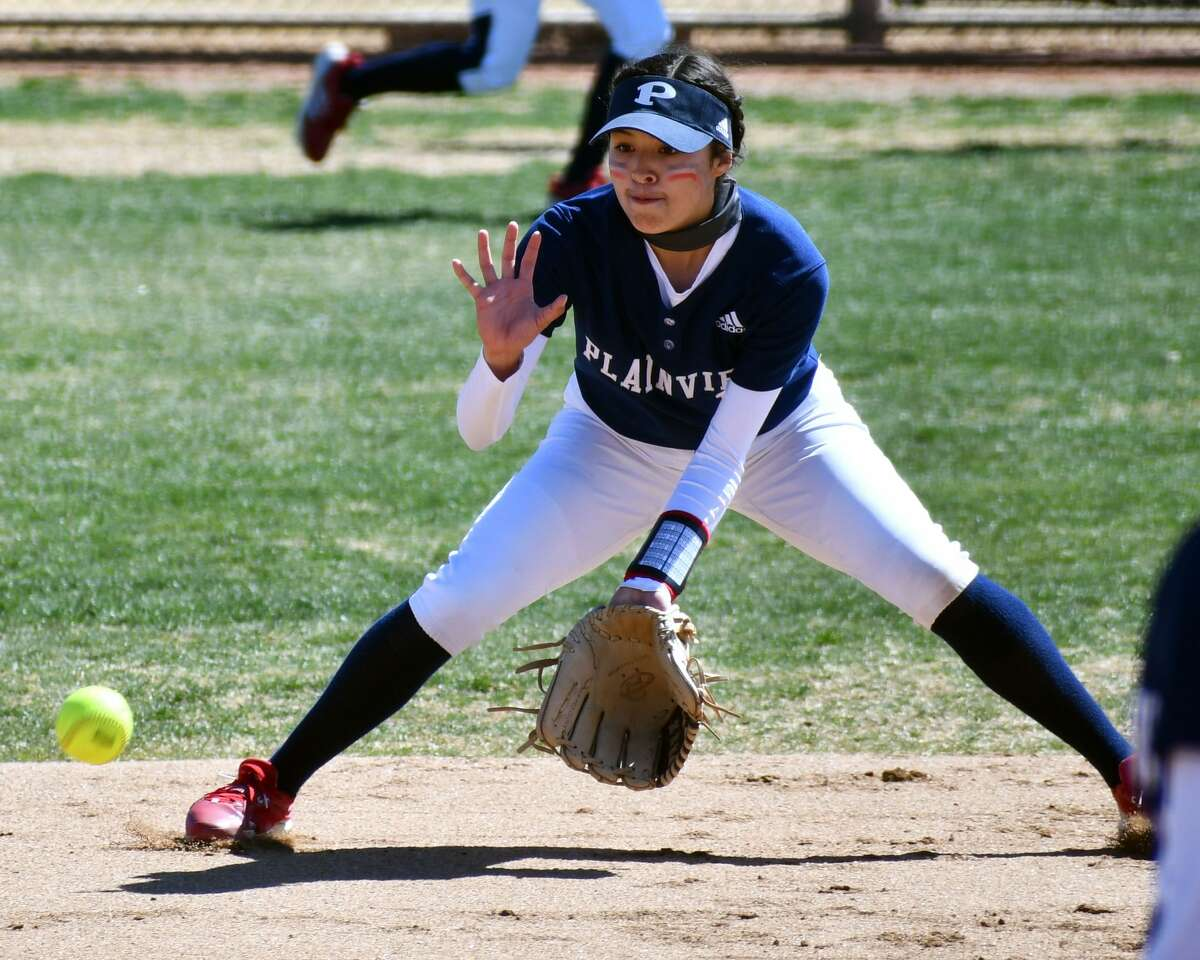 Plainview's Mikayla Carrillo scoops up a ground ball during a non-district softball game against Big Spring on Friday at Lady Bulldog Park.