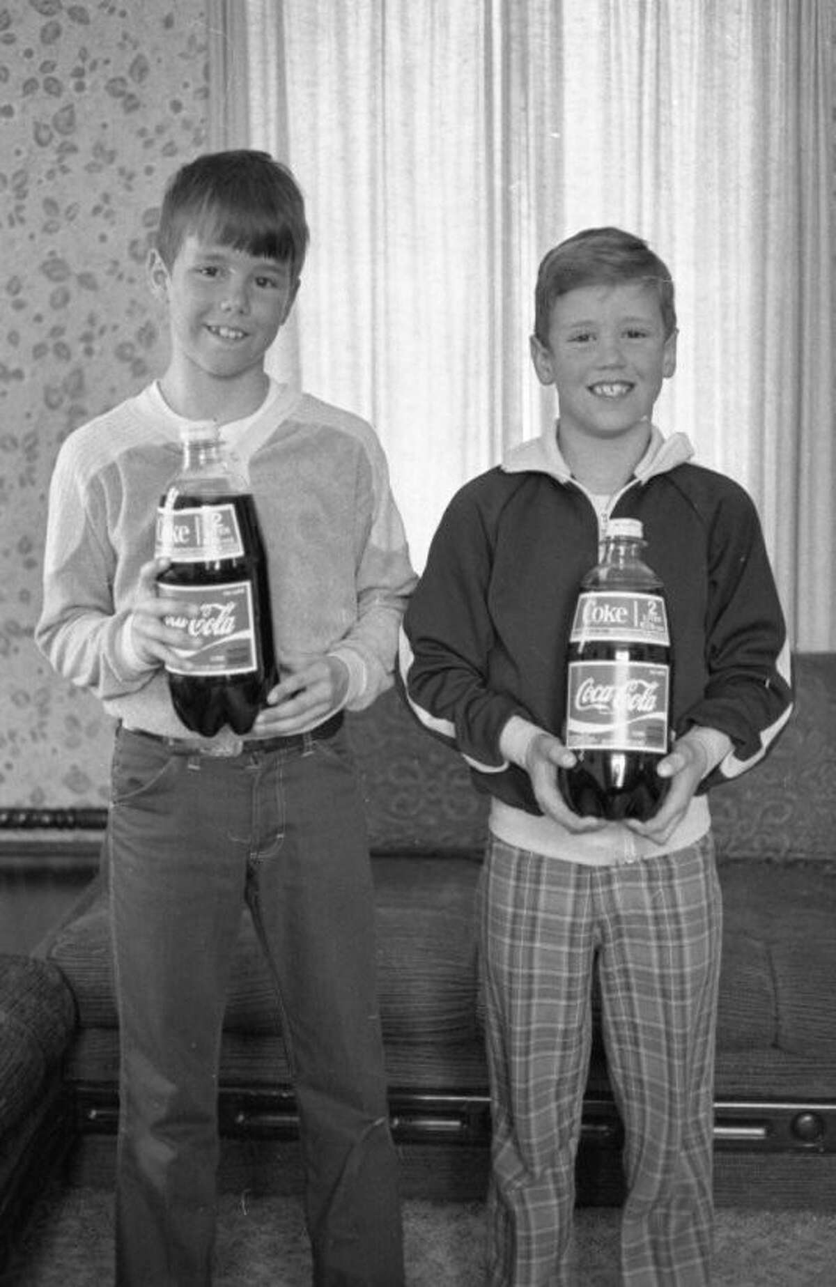 (From left) James Tidd and brother Scott, were winners of a paper carrier contest sponsored by the News Advocate in March of 1981. (Manistee County Historical Museum photo)