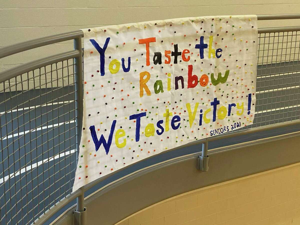 Onekama Consolidated Schools' senior class'sposter hangs in the gymnasium. Each high school class decorated a candy-themed poster as part of the school's snowcoming celebration. (Courtesy photo)