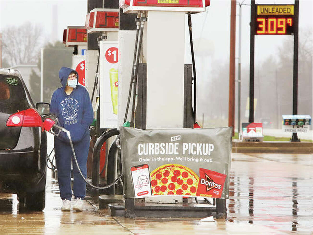 A customer of Casey's Genral Store on Fosterburg Road in Alton pumps gas at nearly $3.10 a gallon Thursday. According to the American Automobile Association, gas prices are 14 percent higher on average than they were in just February of this year. A rise in crude oil prices, the deep freeze in the Gulf Coast and anticipated increases in travel by people are contributing to the higher prices.