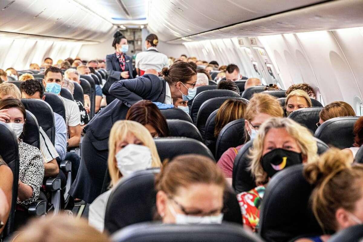 Commercial passengers shoulder to shoulder in June of 2020.