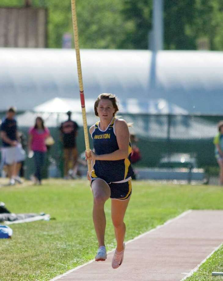 contributed photo\Bruce Ando Weston senior captain Emily Ando set a State Open record in the pole vault by leaping 12-.25 on Monday. Photo: Bruce Ando  Andophoto, ST / © Bruce Ando 2010