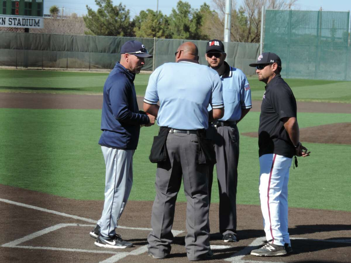 Midland Christian head coach Mike Robles, right, and Fort Worth All Saints head coach Mike Fehler, left, talk with the umpires before a March 18 baseball game at Christensen Stadium.