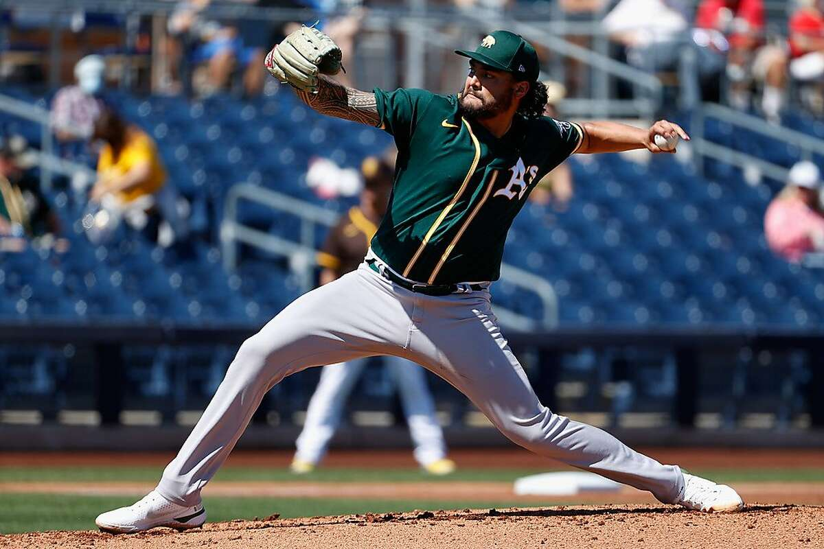 PEORIA, ARIZONA - MARCH 18: Starting pitcher Sean Manaea #55 of the Oakland Athletics pitches against the San Diego Padres during the first inning of the MLB spring training game at Peoria Sports Complex on March 18, 2021 in Peoria, Arizona. (Photo by Christian Petersen/Getty Images)