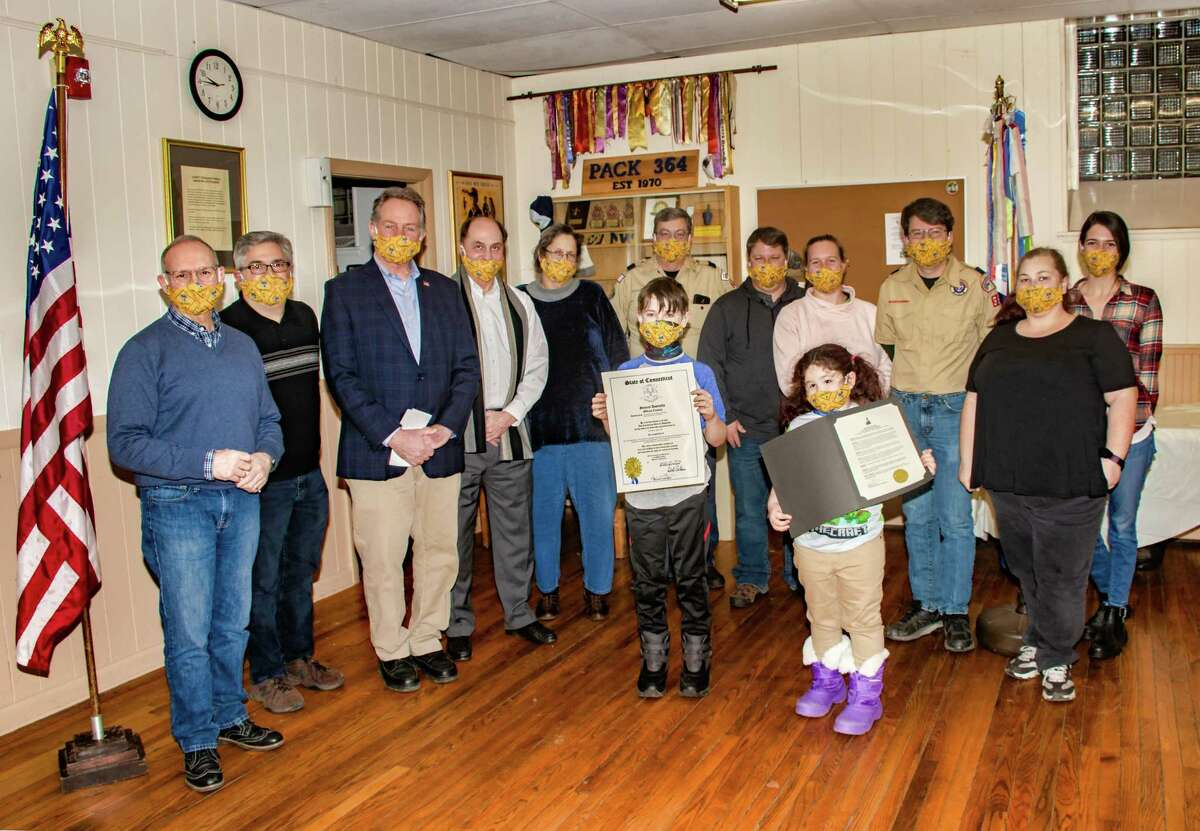 Due to extreme cold on March 4, this group photo was taken inside of the Saint Thomas Church Hall in Thomaston. From left: State Sen. Henri Martin (R-31), Saint Thomas Charter representative Ken Santopietro, State Rep. John Piscopo (R-76), Thomaston First Selectman Ed Mone, retired Scout District and Pack Leader Barbara Peck, Pack Chairman Mike Leclerc, former Cub Scoutmasters Kyle and Elizabeth Hill, Past Cub Scoutmaster and Eagle Scout Brendan McDonald, Scout Leader Samantha Butkiewicz and her children, and current Cub Scoutmaster Jordan Burns.