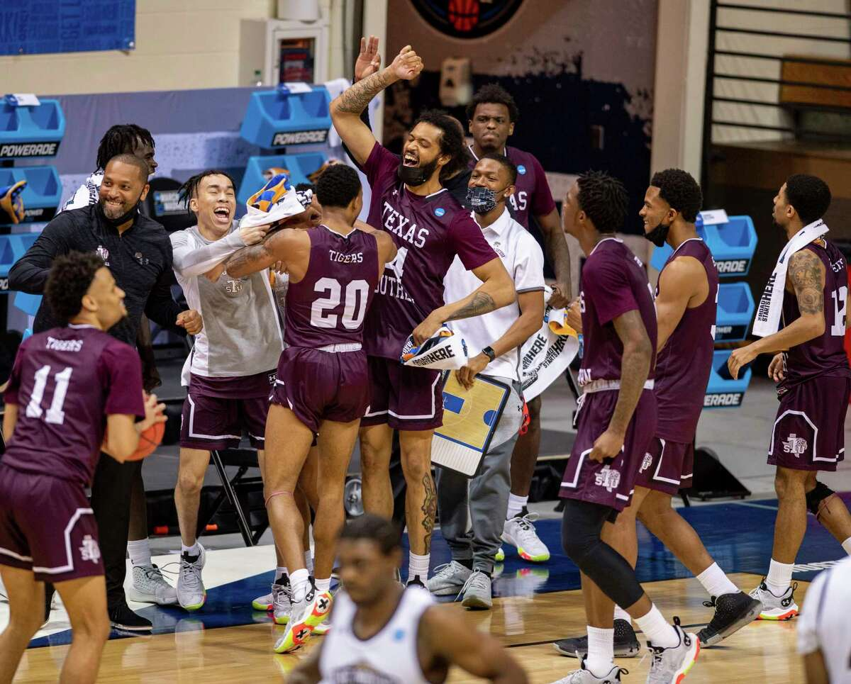 Texas Southern players celebrate after defeating Mount St. Mary's in a First Four game in the NCAA men's college basketball tournament, Thursday, March 18, 2021, in Bloomington, Ind. (AP Photo/Doug McSchooler)
