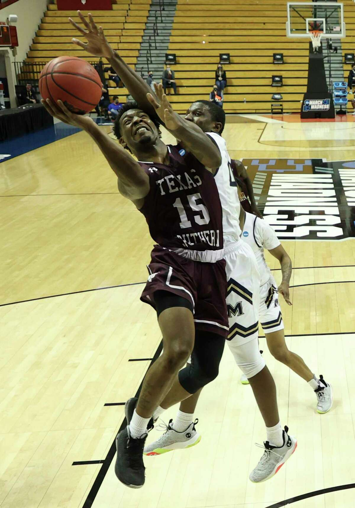 BLOOMINGTON, INDIANA - MARCH 18: Justin Hopkins #15 of the Texas Southern Tigers drives to the basket during the second half against the Mount St. Mary's Mountaineers in a First Four game during the NCAA Men's Basketball Tournament at Assembly Hall on March 18, 2021 in Bloomington, Indiana.