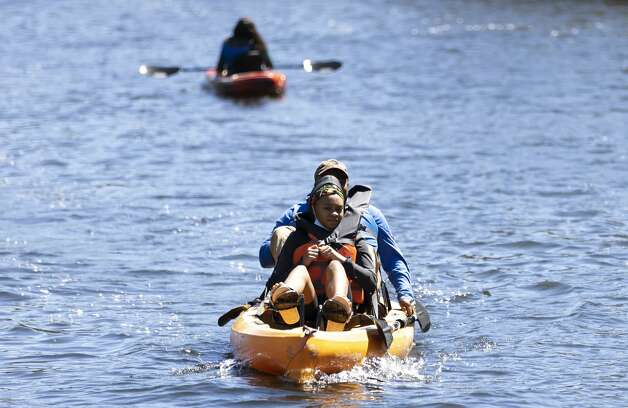 Kayakers paddle down The Woodlands Waterway at Town Green Park, Thursday, March 18, 2021, in The Woodlands. Temperatures through the weekend are expected to range between the 60s-70s according to the National Weather Service. Photo: Gustavo Huerta/Staff Photographer / Houston Chronicle © 2021