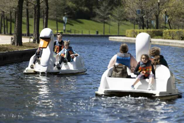 Family and friends ride along The Woodlands Water Way on duck shaped boats at Town Green Park, Thursday, March 18, 2021, in The Woodlands. Temperatures through the weekend are expected to range between the 60s-70s according to the National Weather Service. Photo: Gustavo Huerta/Staff Photographer / Houston Chronicle © 2021