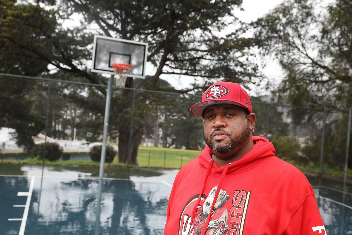 Drew Jenkins, Mercy Housing developer and community leader, stands on the basketball court at Herz Playground in San Francisco. Thirty years after he and fellow basketball players asked for a community gym, and now it's finally happening.
