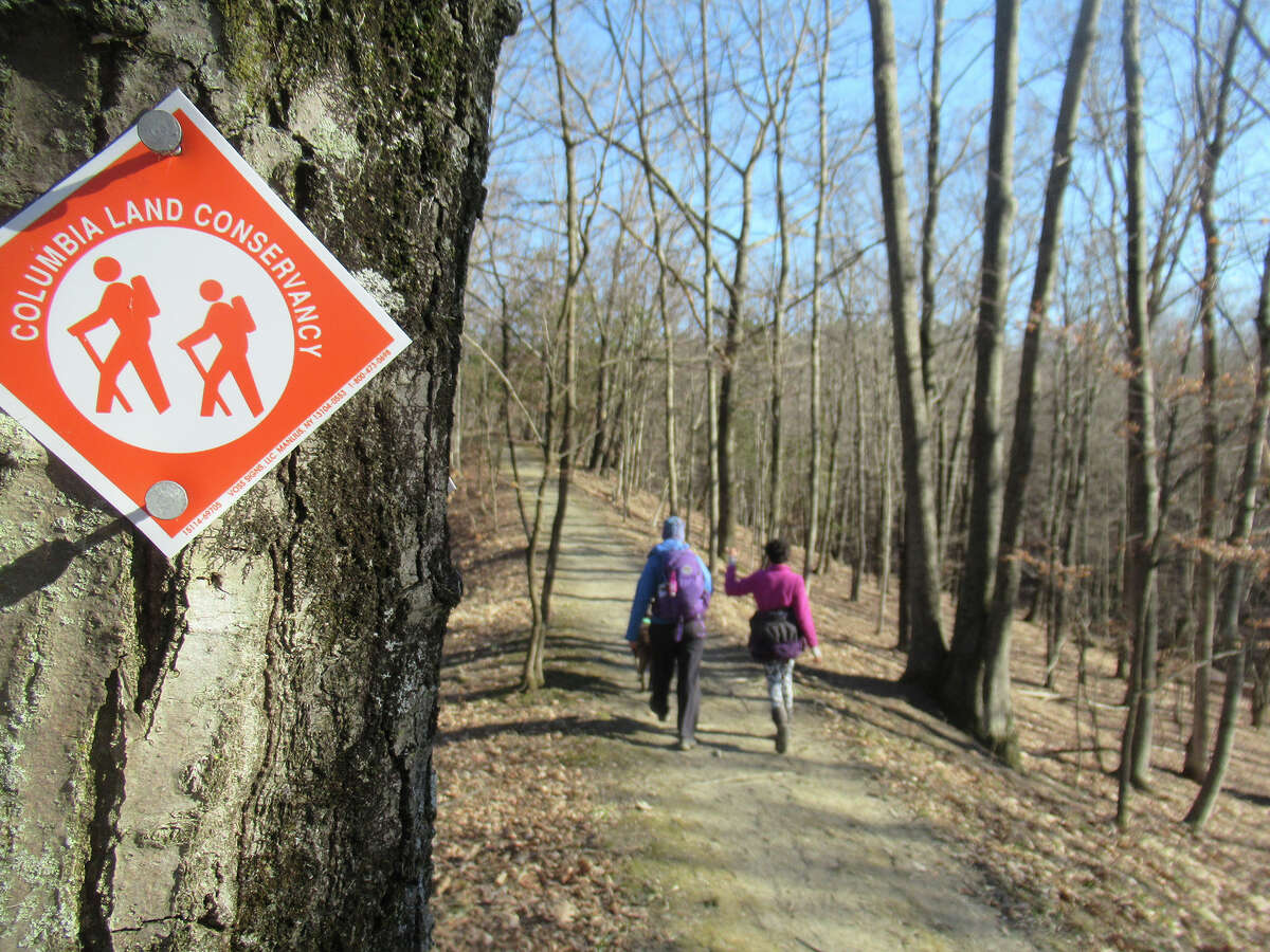 Gillian Scott and her daughter walk the orange trail at the Greenport Conservation Area outside Hudson.