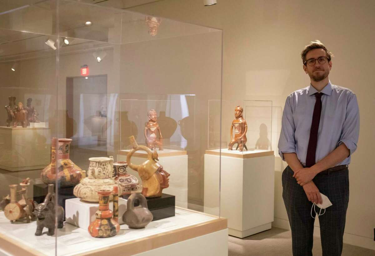 """Curator Matthew Ward poses for a portrait by the """"Precolumbian Lifeways"""" exhibit as seen March 3, 2021, at the Museum of the Southwest. Jacy Lewis/ Reporter-Telegram"""