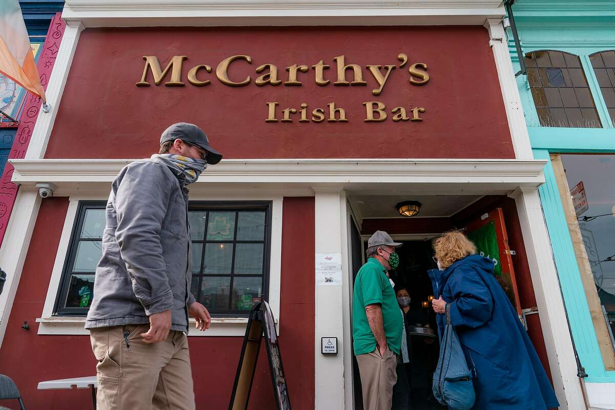 Patrons waited to enter McCarthy's Irish Bar in San Francisco on St. Patrick's Day.