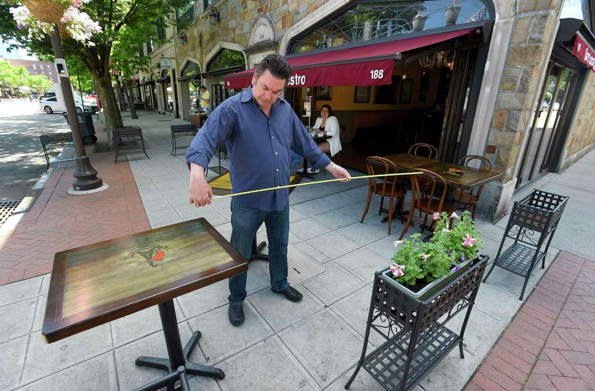Owner Alain Bars of Chez Vous Bistro on Bedford Street sets up an outdoor dining area on May 30, 2020 in Stamford.