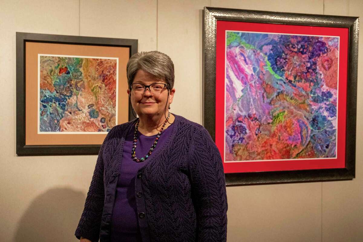 """Rebecca Dodge poses in front of """"Texas as Art"""" pieces on March 2, 2021, at the Sibley Nature Center. Jacy Lewis/ Reporter-Telegram"""