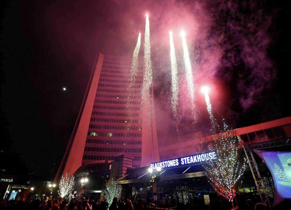 Fireworks are launched above Broad Street and the Landmark Building in Stamford, Conn. as part of the Heights & Lights celebration on Sunday, December 8, 2019.