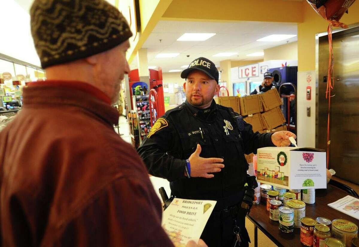 Mark August, left, of Bridgeport, talks with School Resource Officer Dani Soto in 2018.