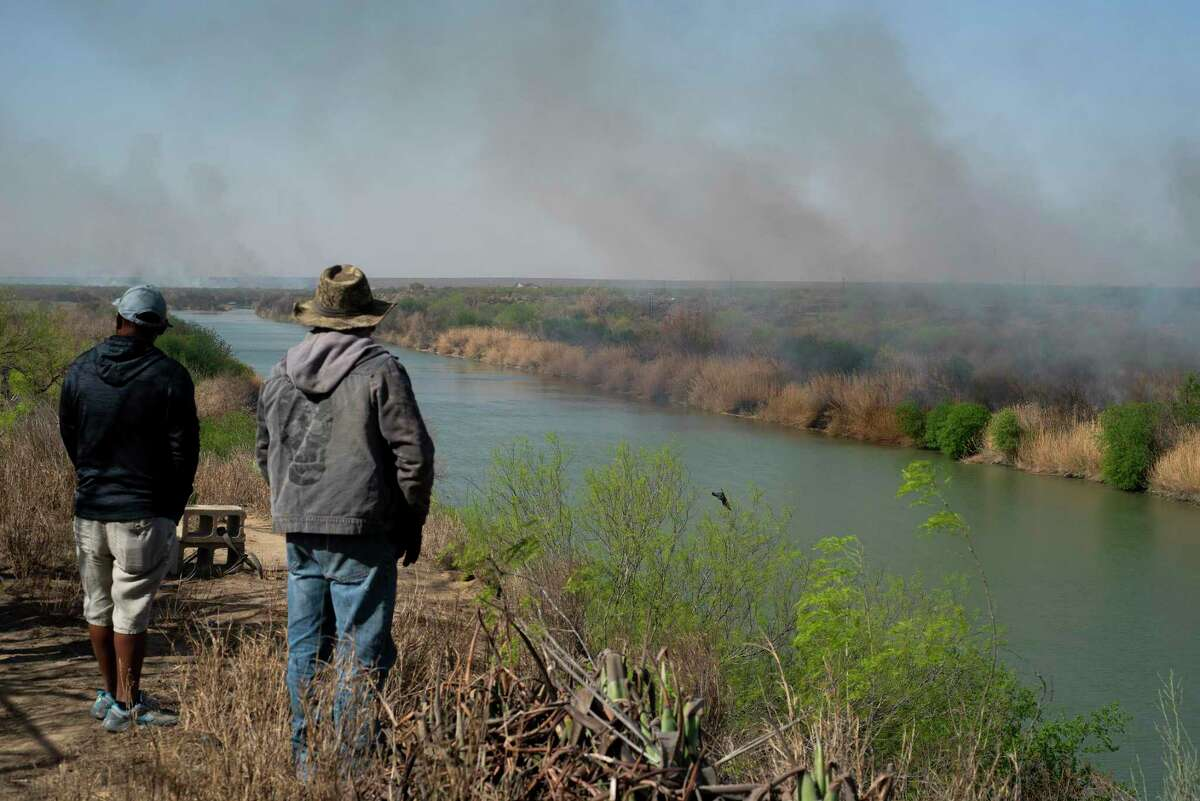 Affected El Cenizo residents who do not wish to be identified remain vigilant about concerns the bushfires could spread to the American side of the Rio Grande near El Cenizo, Texas on Thursday, March 18, 2021.