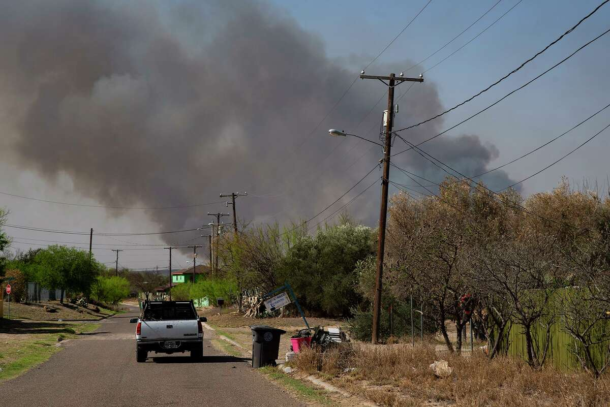 On Thursday, March 18, smoke rose on a nearby private ranch near El Cenizo as residents worried about the spread of bushfires in their town.