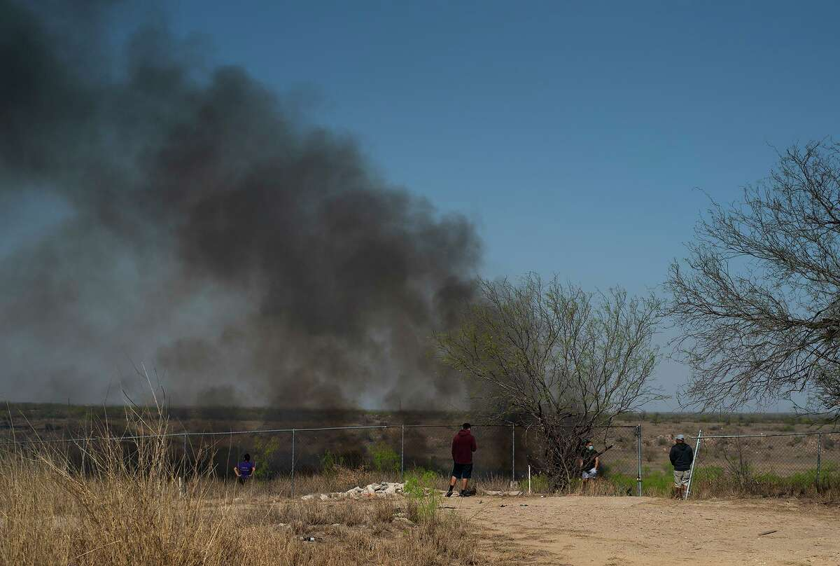 Affected El Cenizo residents who do not wish to be identified remain vigilant over concerns the bushfires could spread to the American side of the Rio Grande near El Cenizo, Texas on Thursday, March 18, 2021.