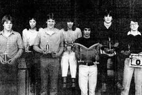 (From left) Onekama High School student athletes Greg Howes, Shari Buckner, Blake Fitch, Melody Johnson, Tom Bromley, Tom Foster and Joe Booher are shown with awards and trophies. The photo was published in the News Advocate on March 20, 1981. (Manistee County Historical Museum photo)