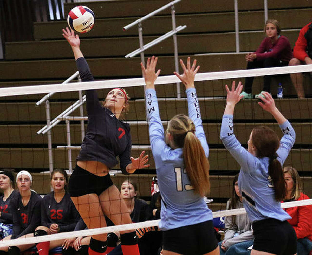 Staunton's Haris Legendre (left), shown hitting in a Macoupin County Tourney match against North Mac last season in Carlinville, had 13 kills Thursday night in the Bulldogs' SCC victory over Pana. Staunton halted Pana's SCC win streak at 28 in a row.