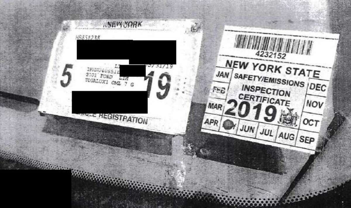 A photo of the DMV inspection sticker issued by Mavis to Nauman Hussain in May of 2018 for his stretch Excursion limo, along with the DMV registration sticker. The NTSB says Hussain should not have been able to receive either under state law.