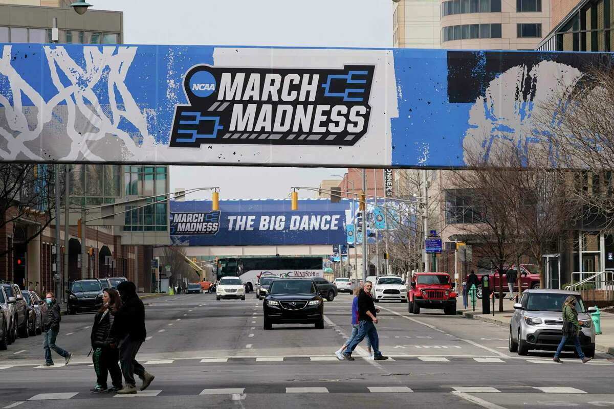 March Madness banners for the NCAA college basketball tournament cover crosswalks in downtown Indianapolis on Wednesday.