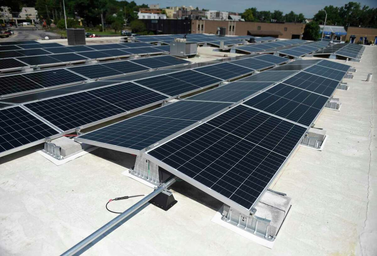 New solar panels are installed at DiMare Pastry Shop & Cafe in Stamford, Conn. Tuesday, July 21, 2020. The bakery's new solar energy system was financed through the Connecticut Green Bank's Commercial Property Assessed Clean Energy (C-PACE) program. The C-PACE program allows businesses to install energy upgrades immediately and pay for them over time as an addition to their property taxes. The solar PV system, installed by 64Solar, is will save the business more than $20,000 a year on electricity costs.