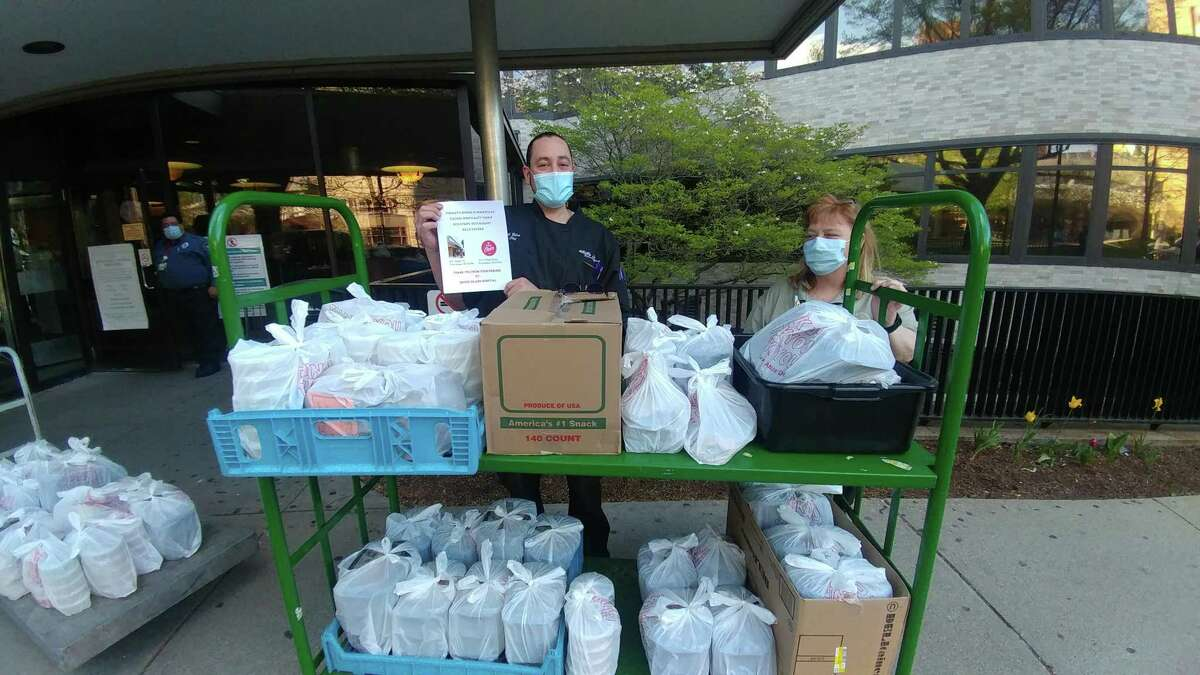 """Chef Ed Bolus of Mill's Tavern drops off food to LifeSpan employees at Rhode Island Hospital as part of the """"Meals with a Mission"""" campaign undertaken by Encore Hospitality, which is owned and operated by Ocean State Job Lot, in May 2020."""