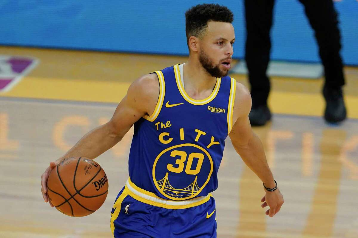 Golden State Warriors guard Stephen Curry dribbles against the Utah Jazz during the first half of an NBA basketball game in San Francisco, Sunday, March 14, 2021.