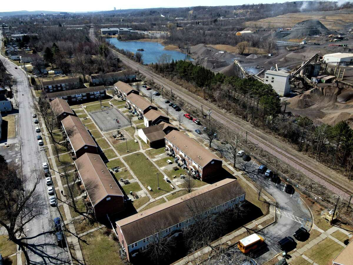 View of the Saratoga Sites Apartments showing its proximity to the Norlite aggregate and incinerator plant on Friday, March 19, 2021, in Cohoes, N.Y. Local residents are suing Norlite and parent company Tradebe over claims of exposure to hazardous silica dust that contains harmful glass particles known to cause silicosis and various other aliments. (Will Waldron/Times Union)