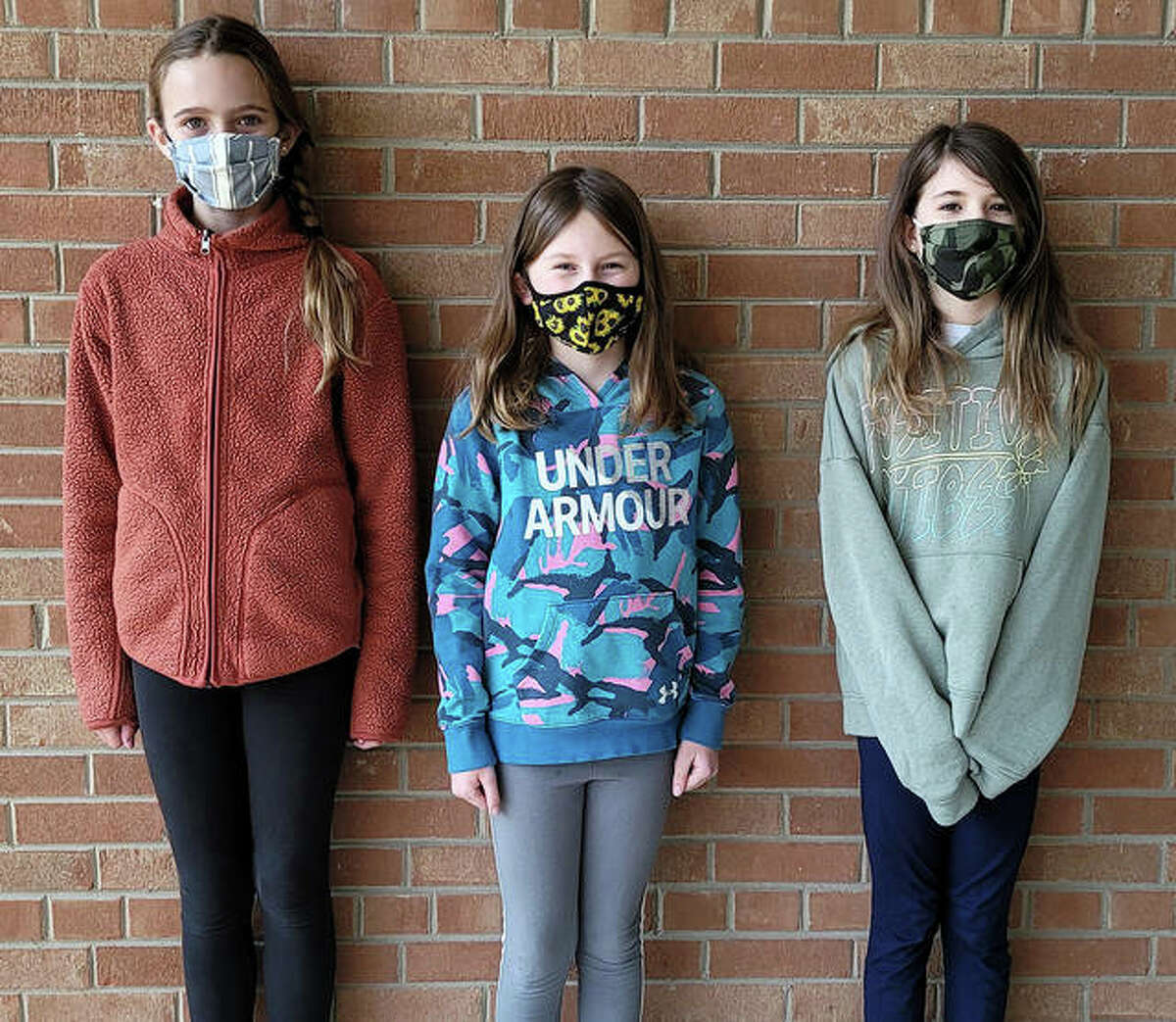 Woodland Elementary School young authors: from left, Maggie Hertz, fifth grade, Nora Moore, third grade, and Clara Johnson, fourth grade.
