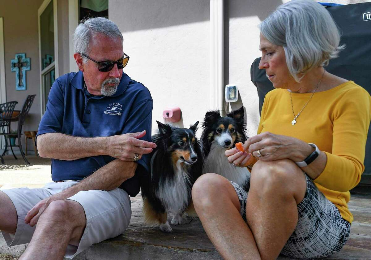 Steve and Candi Robinson play with their Shetland sheepdogs, Sochi and Lexi, at their Fair Oaks Ranch home. The dogs were so high-strung they barked if either of them sneezed too loudly.