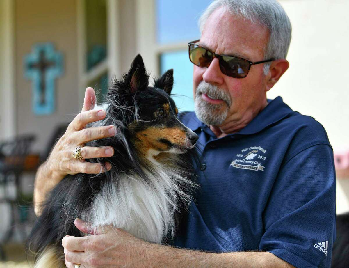 """Steve Robinson lavishes one of the family Shelties, Sochi, with attention . He and his wife Candi broke the dogs of their barking habit by loudly saying """"shush"""" whenever they started."""