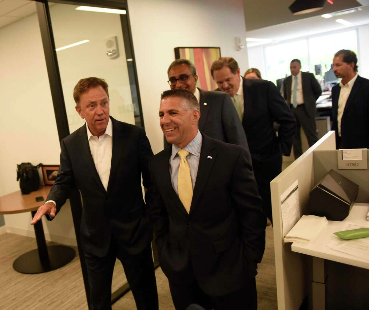 Gov. Ned Lamont, left, toured the offices of professional-services firm KPMG during a ribbon-cutting event on July 15, 2019 at 677 Washington Blvd., in downtown Stamford, Conn.