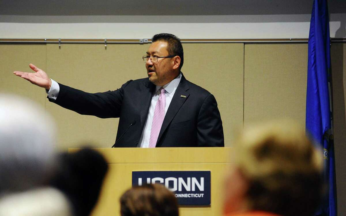 """UConn Stamford director Terrence Cheng speaks during the annual convocation inside the GenRe Auditorium in Stamford, Conn. on Wednesday, Sept. 13, 2017. Cheng lead a panel on Thursday entitled """"Anti-Asian Violence and the Fight Against Invisibility."""""""