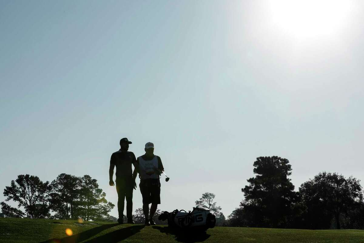Players walk off the third green during the second round of the Vivint Houston Open at Memorial Park Golf Course on Friday, November 6, 2020.