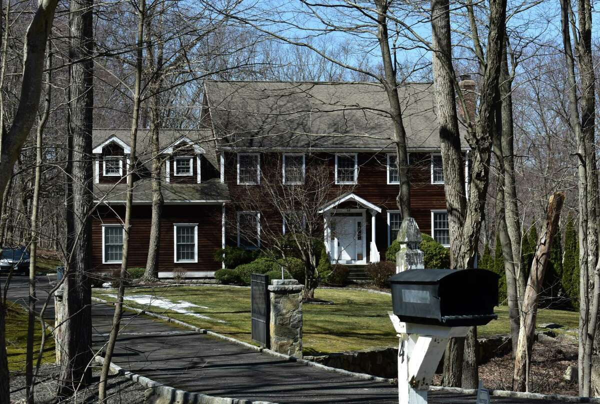 A home just off Limekiln Road in Redding, Conn., listed for sale through Coldwell Banker for $965,000 on Thursday, March 18, 2021, 15 years after its current owner paid $835,000 for the property. Connecticut sellers have been emboldened by multiple offers since the start of the COVID-19 pandemic, with buyers expressing frustration with competitive bids getting brushed aside for better offers.