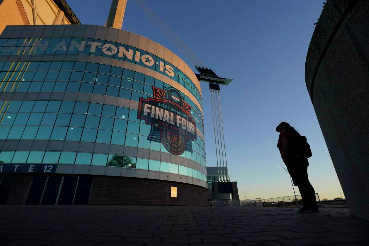 A visitor looks up at the logo for the Women's Final Four at the Alamodome.