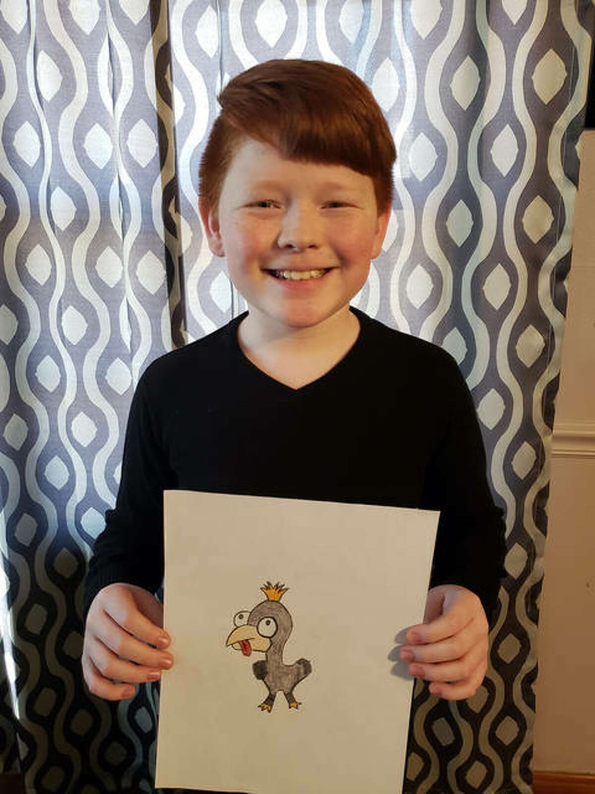 Nick Rekowski, 11, shows off his creation, Kevin the Bird. Nick's design will be converted to a plush toy and sold in IKEA stores worldwide later this year.